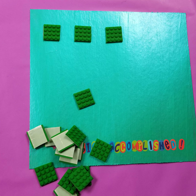 add squares of toy block tape to your DIY reward chart for kids
