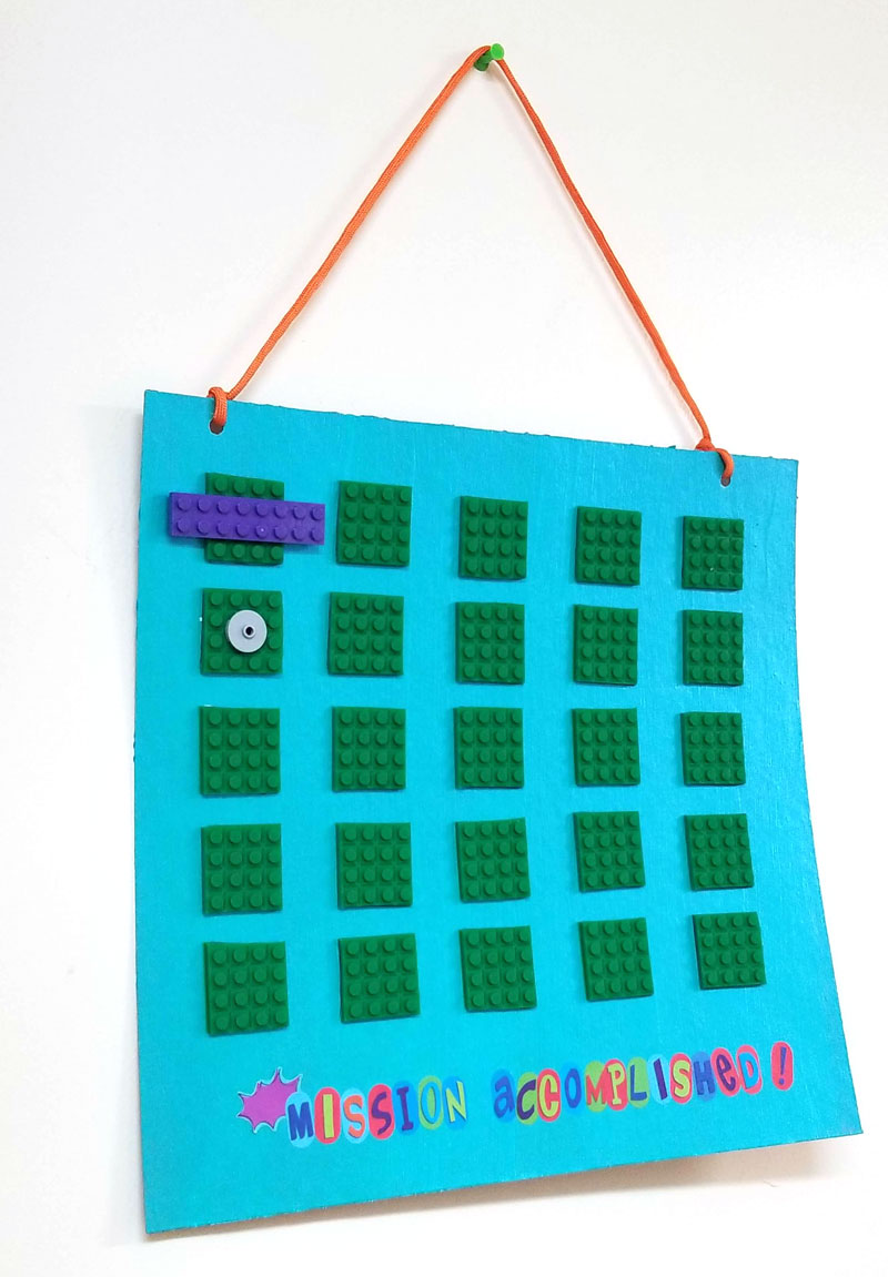 Punch holes and add string to your DIY reward chart for kids