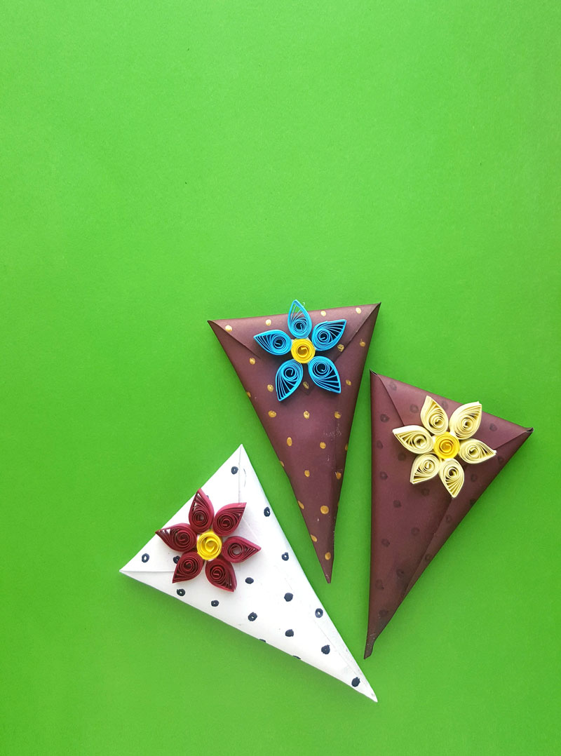 This simple paper quilling gift wrapping idea is perfect for Valentine's day or for gift wrapping at any time of the year. This simple gift wrap trick is a DIY cone gift box made out of regular scrapbook or crafting paper.