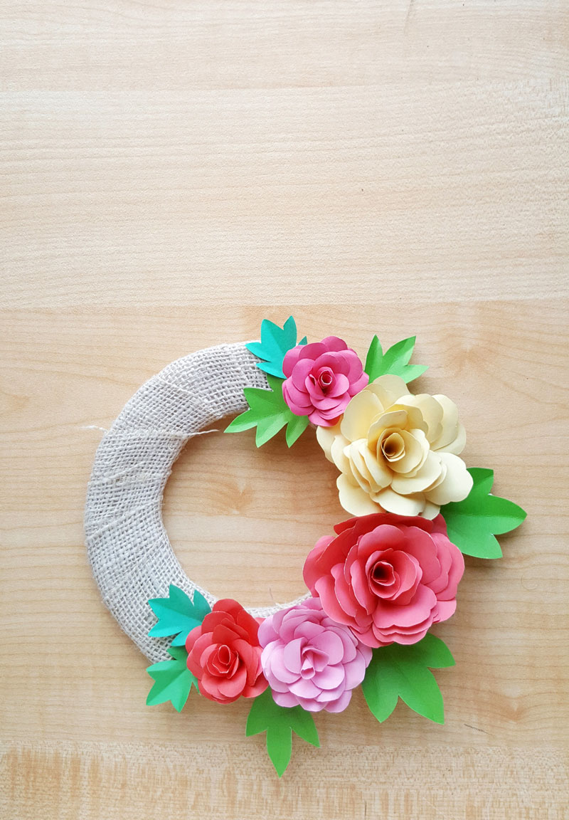 Learn how to make your own DIY paper roses with a free printable paper flower template