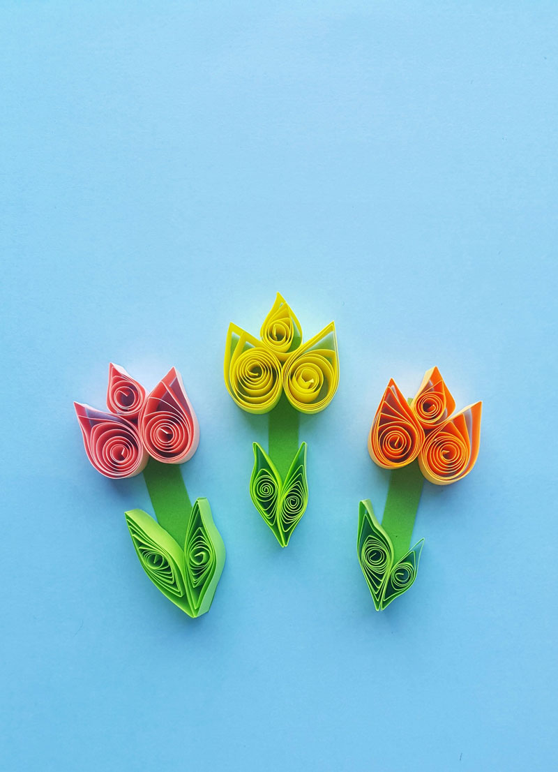 Click to learn how to make these gorgeous paper quilling tulips -a fun and easy beginner quilled paper flower tutorial and spring crafts for teens!