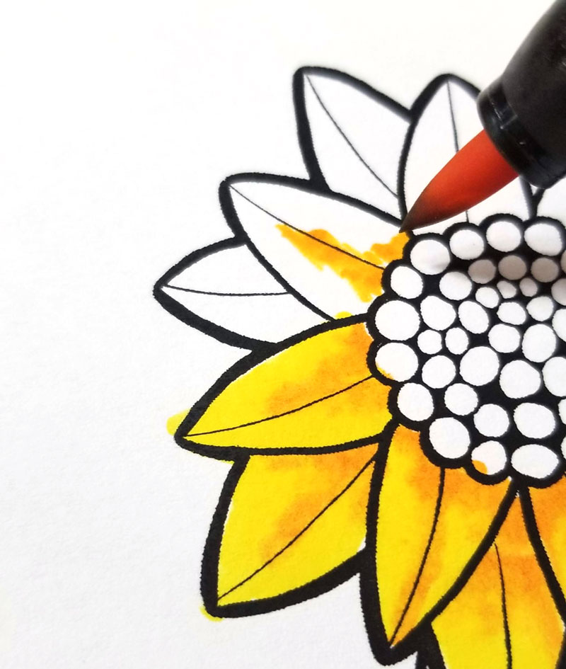 Shading sunflowers on motivational coloring pages step 2