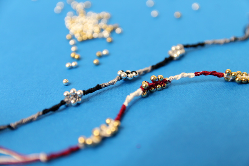 easy beaded friendship bracelets photographed with bokeh on a blue background