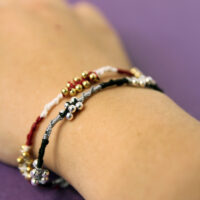 photo showing a hand modeling easy beaded friendship bracelets