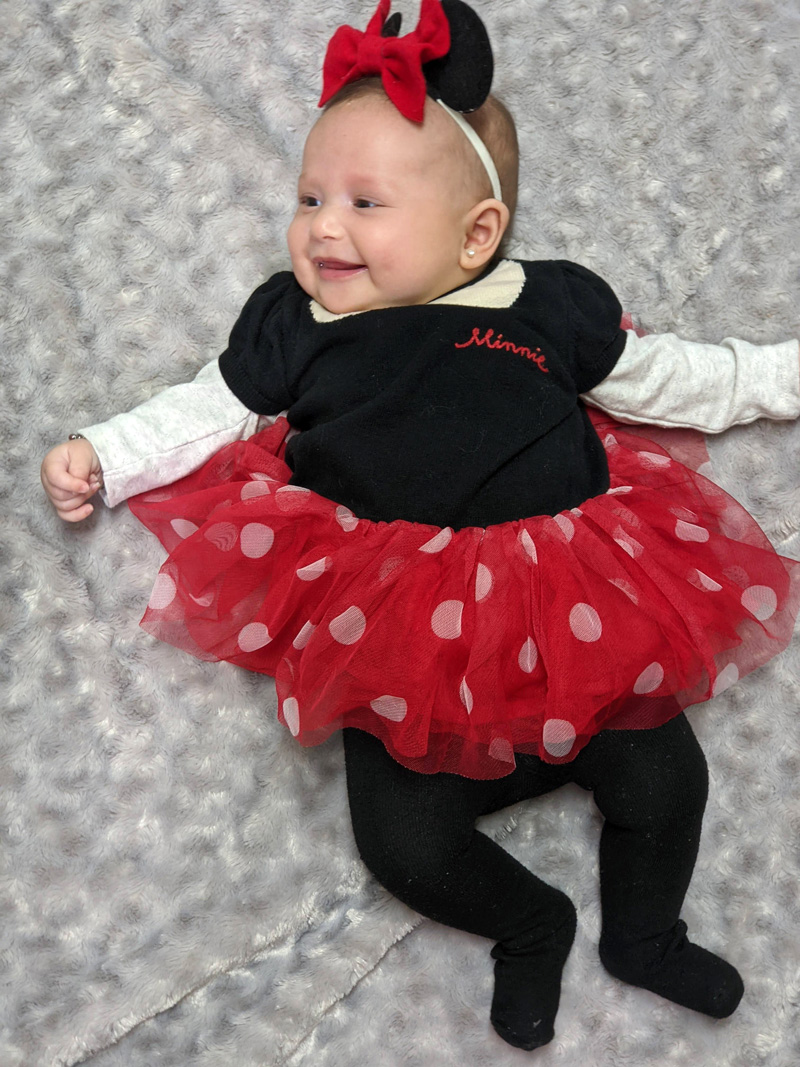 final modeled shot of Minnie Mouse ears for babies on smiling princess